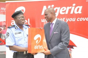 Chief Executive Officer & Managing Director, Airtel Nigeria, Segun Ogunsanya presenting a gift to Deputy Commissioner of Police (Administration), Lagos State and representative of Commissioner of Police, Lagos State, Felix G. Ogundeji at the Commissioning of a Police Post renovated by Airtel,  in Lagos
