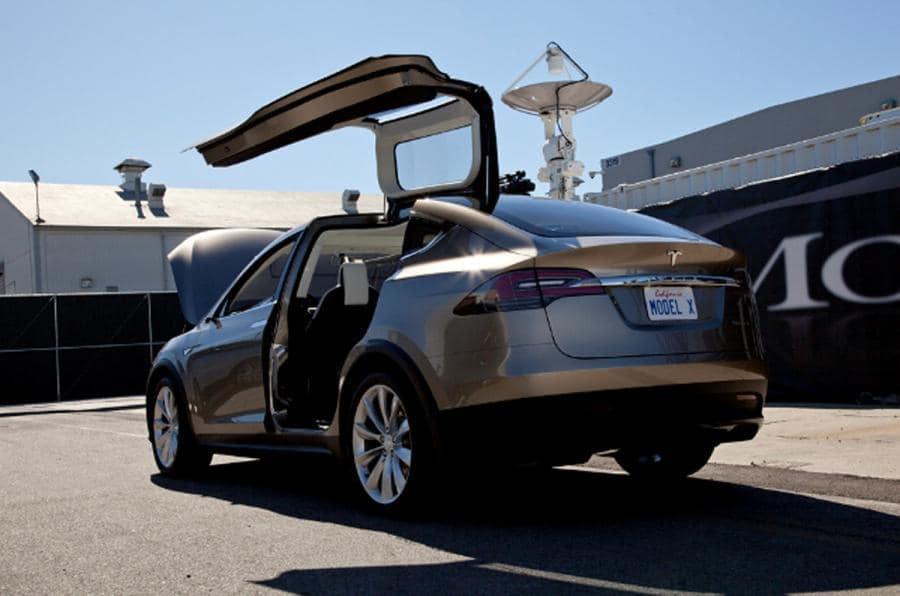 Tesla urges caution as it launches autopilot update